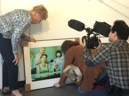 Life imitating art or art imitating life? Suzanne & her mother looking at themselves in the mannequin wedding day photo created by Suzanne. copyright IMITATING LIFE 2015