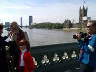 Filming on Westminster Bridge, London with our documentary cameraman, Stephen Reynolds setting up his next shot as Suzanne adjusts Chauncey's necktoe